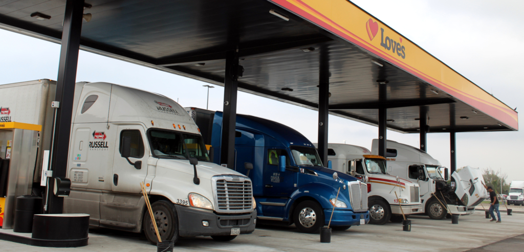 Truckers make a stop at Love's fuel pumps.