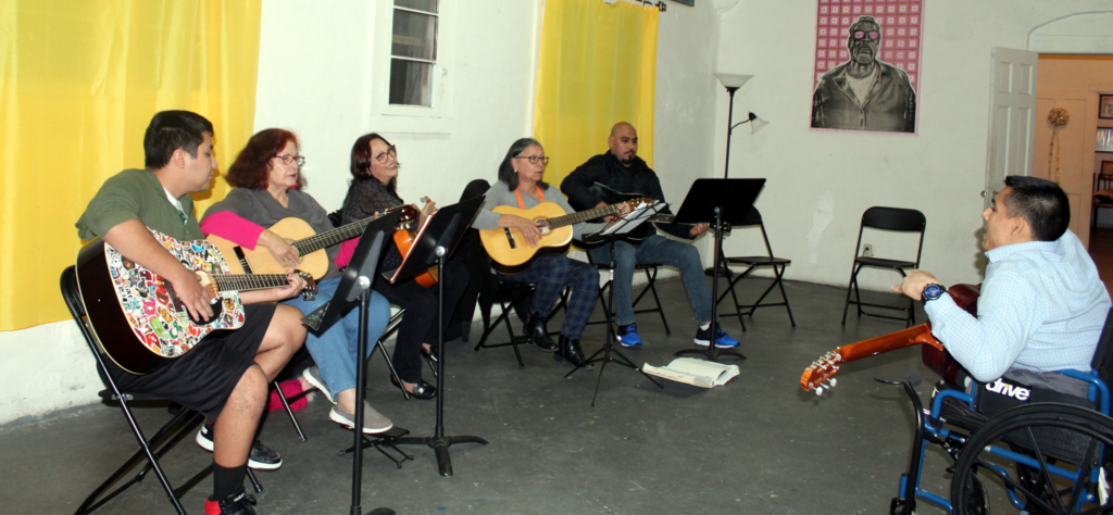 Guitar instructor Juan Torres gives intermediate lessons to students on a recent Tuesday.