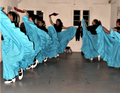 Adults practice folkloric dance at the Carlotta K. Petrina Cultural Center.