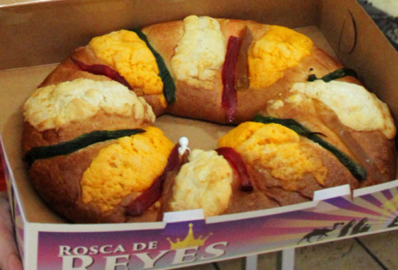 An employee at Ayala's Bakery in Brownsville shows a Rosca de Reyes panaderias.