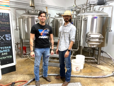 5x5 Brewing Co. brewers and apprentices Joe Rivas and Cody Mazur take a break from the brewing/production process. (VBR)