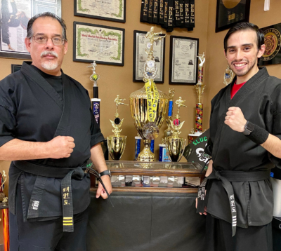 Founder Sensei Gilberto Villanueva and son (and co-owner) Sensei Marco Antonio Villanueva, proud of Team Tiger Martial Arts' accomplishments.