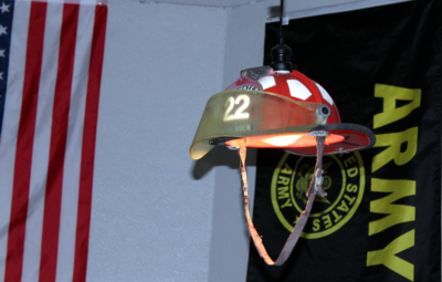 The ceiling light in the lounge area of Kickin Axes RGV in McAllen is made from a firefighter's helmet.