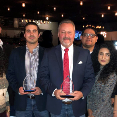 The team from SWG Engineering LLC accepts the 2019 Innovative Project of the Year award. Randall Winston, center, holds the 2019 Civil Engineer of the Year award from the American Society of Civil Engineers Rio Grande Valley Branch.
