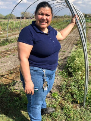 Diana Padilla stands on farmland at her Yahweh's All Natural Farm and Garden.
