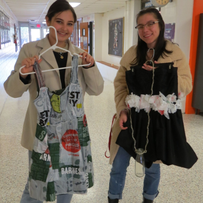 Gisselle Costa and Denisse Damken in the hallway of McAllen ISD's Lamar Academy, showing recyclable fashions in their Modern Chaos line.