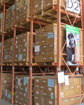"""""""Hope for a Better Tomorrow"""" reads the poster on the Food Bank of the Rio Grande Valley's warehouse shelves. (VBR)"""