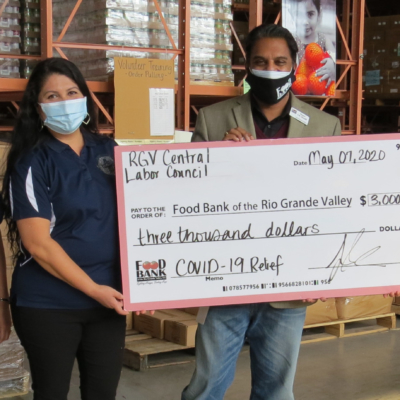 Indeera Mohammed, McAllen AFT organizer, and Sylvia Tanguma, McAllen AFT president, present a check for $3,000 to Stuart I. R. Haniff, chief executive officer for the Food Bank of the Rio Grande Valley, and his executive assistant, Gabriela Parra, on behalf of the members of the Central Labor Council, McAllen AFT and the Texas AFL-CIO. (VBR)