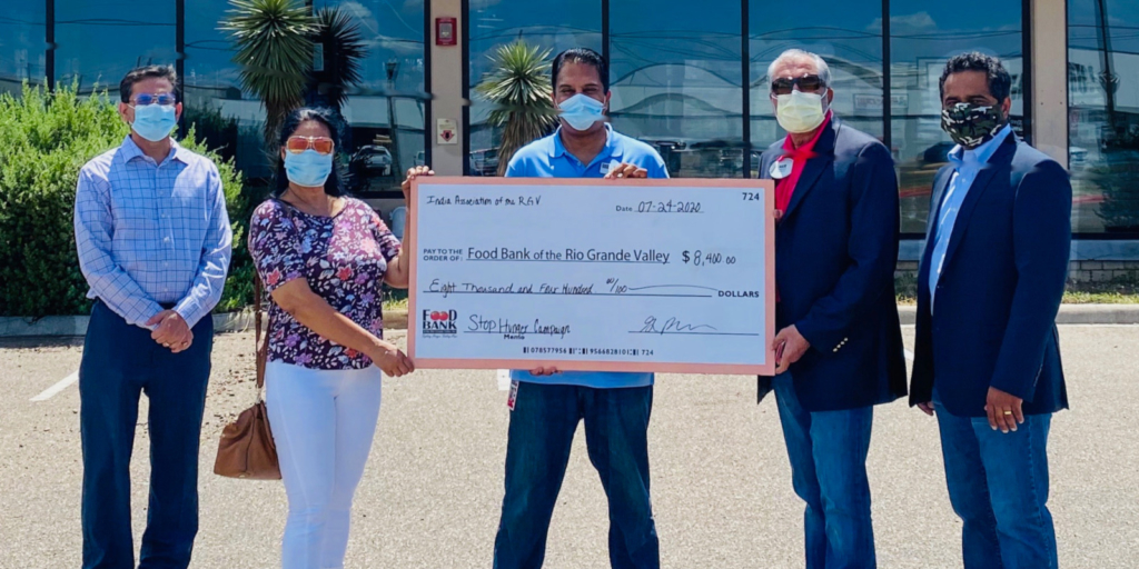 Hari Namboodiri and Dr. Shima Choudhary, president and secretary of the India Association of Rio Grande Valley, present a check to Food Bank CEO Stuart Haniff. Joining them are India Association board members Sreekanth Nangavaram and KV Kanneganti.