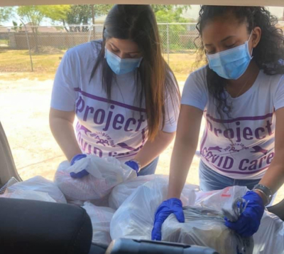 Project COVID Care volunteers Amanda Trevino and Alexa Hernandez help to get essential services to the elderly and disabled. (Courtesy)