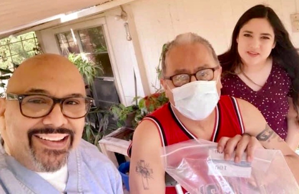 Johnny Llanes and Drea Labanzat make a delivery to a resident in need. (Courtesy)