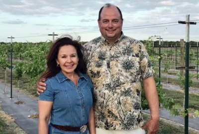 Melissa and Art Delgado at their vineyard near Los Fresnos.