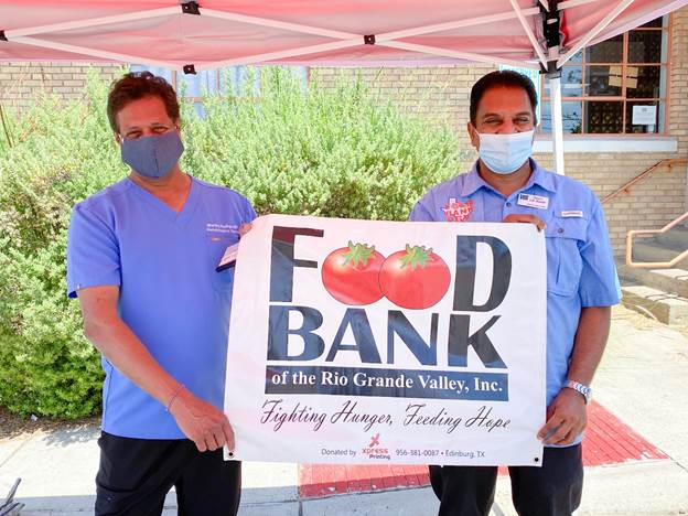 Dr. Murthy Badiga and Food Bank of the Rio Grande Valley CEO Stuart Haniff