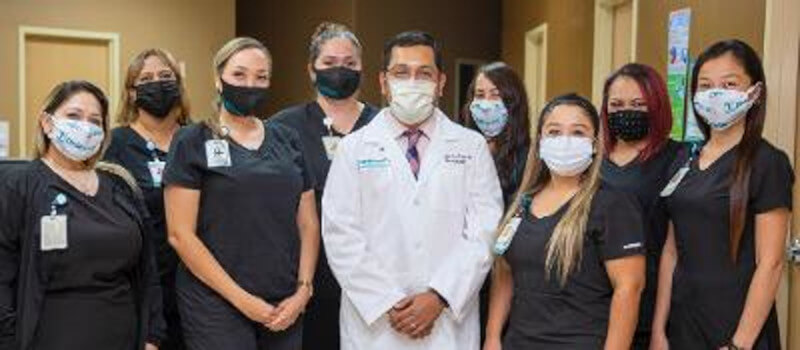 Dr. Alejandro Cruz and the staff at DHR Health Neurology Institute.