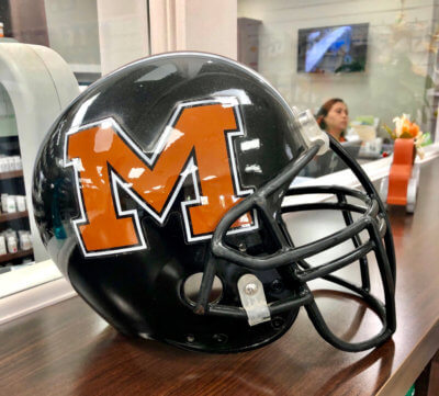 A Mercedes Tigers football helmet on display at Mid-Valley Pharmacy.