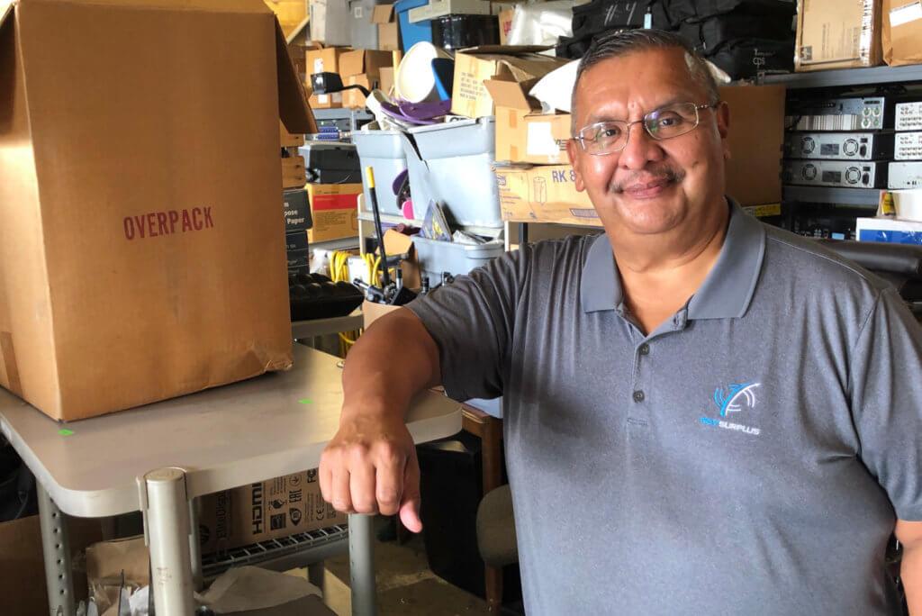 Juan Rosales in his warehouse at RGV Surplus.