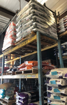 High stacks of cattle and livestock feed in Martin Farm & Ranch's warehouse north of Edinburg.