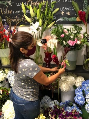 Mariana Linaldi-Rodriguez sorts through flowers in her marketplace room at Southern Roots.