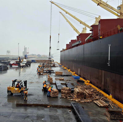 Steel slabs move off ships at the Port of Brownsville. (courtesy)