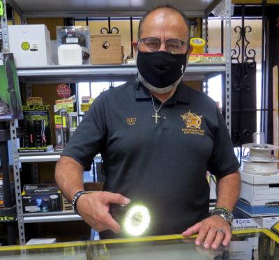 Ric Tamez, owner of RGV SpyTek in McAllen, demonstrates how one of the shop's high-intensity LED flashlights works.
