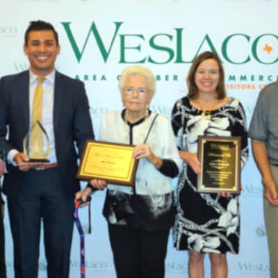 Weslaco Chamber President/CEO Barbara Garza in 2019 with the 2019 award winners: Velma Hirlas of Peter Piper Pizza, Luis Reyes, Mary Mattar, Carla McCaleb, Joe Vidales and Emiliano Montenegro.